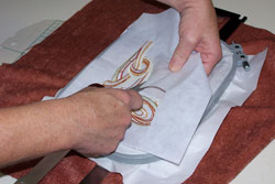 Cut away the cut-a-way machine embroidery stabilizer.