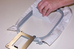 Remove the backing from the Sticky machine embroidery stabilizer.